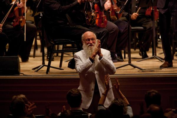 """Terry Riley accepting enthusiastic applause. He said that his concerto """"leaped into my consciousness as a very spontaneous work, full of the things in music that I find colorful, dynamic, beautiful, challenging, humorous, loving, friendly, joyous, stark and universally minded."""""""