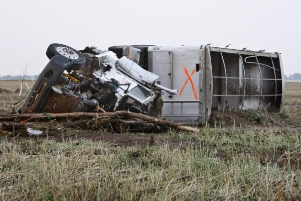 "A truck lies in a field following a tornado in Piedmont. The ""X"" is usually an indication that a vehicle has been checked for survivors."