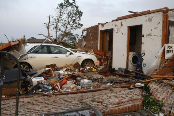 A car sits in what used to be the garage of a home in Piedmont.