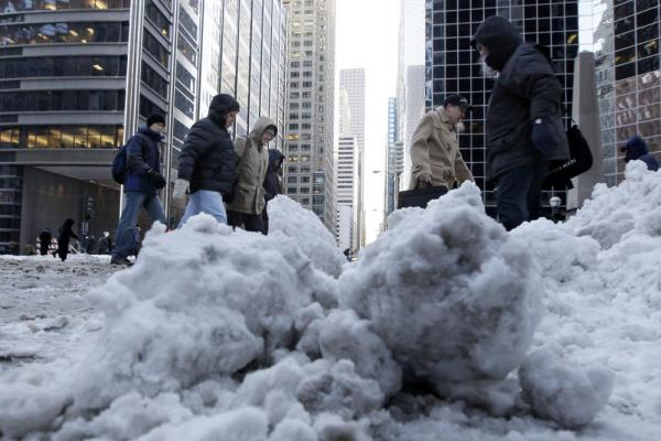 Commuters brave subzero wind chills as they return to work Thursday in Chicago.
