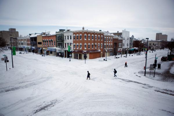The downtown area near the University of Iowa is a virtual ghost town after the storm moved through the Midwest on Wednesday in Iowa City, Iowa.