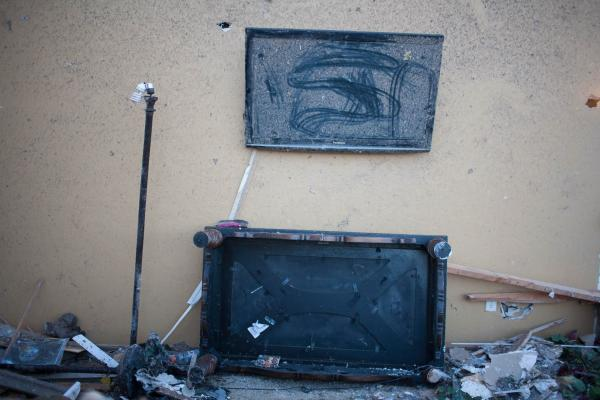 A dusty TV screen is seen in a home in the Heatherwood subdivision in Moore, Okla., on Wednesday, damaged by the tornado that hit Monday.