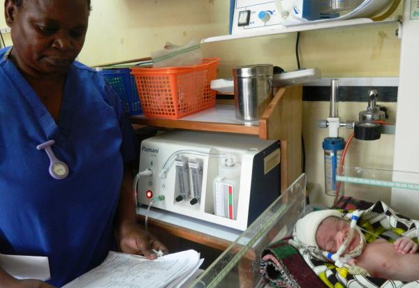 Neonatal nurse Florence Mwenifumbo monitors a newborn receiving bubble CPAP treatment in Blantyre, Malawi. The device was developed by students at Rice University in Houston.