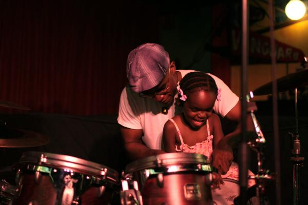 Rudy Royston's daughter Kinyah accompanied him to the Village Vanguard for a performance in 2009.