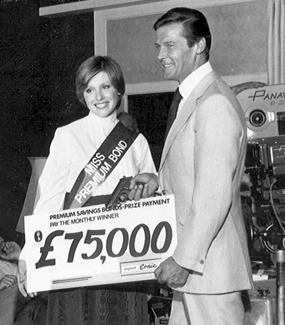 Actor Roger Moore, who played James Bond, poses for a photo promoting Britain's Premium Bonds program.