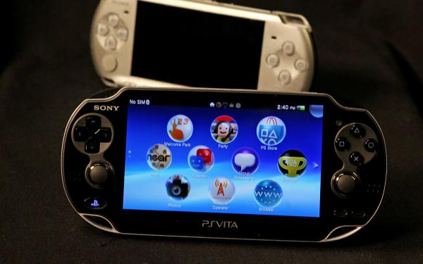 The Playstation Vita and its predecessor the PSP (in the background).
