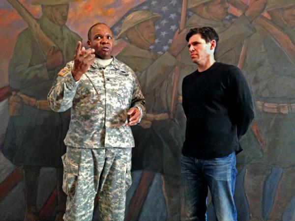 Col. Reginald Sanders, former commander of the 369th Sustainment Brigade, and <em>The Harlem Hellfighters</em> author Max Brooks tour the 369th Regiment Armory in New York City.