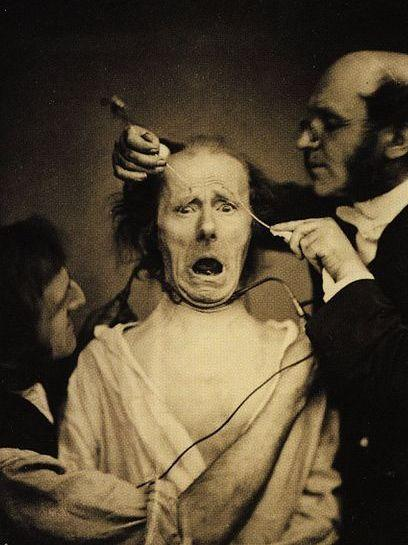 Nineteenth century French neuroscientist Guillaume Duchenne (right) and his assistant force a volunteer to look surprised by electrically shocking muscles in his face.