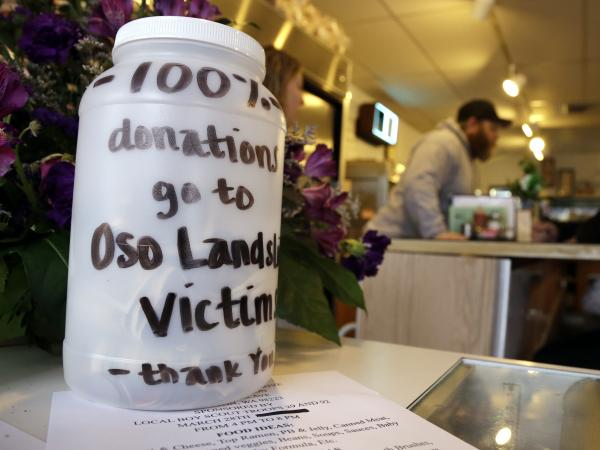 In Arlington, Wash., neighbors and businesses are raising money for the families of those affected by the mudslide in Oso, a part of that city.