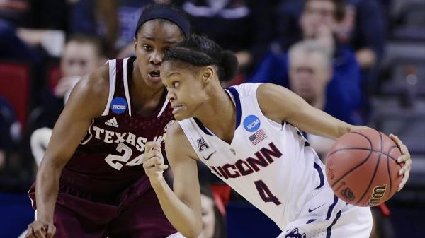 Connecticut's Moriah Jefferson drives past Texas A&M's Jordan Jones during Monday night's game in Lincoln, Neb. Connecticut extended its unbeaten streak and is headed to the women's Final Four.