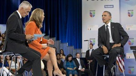President Obama participates in a 2012 town hall hosted by Univision with news anchors Jorge Ramos and Maria Elena Salinas. A conservative media watchdog group says the Spanish-speaking network is biased in favor of Obama and liberals.