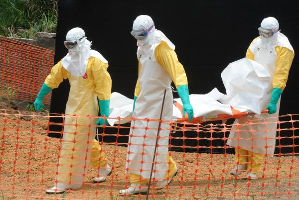 Staff of the 'Doctors without Borders' ('Medecin sans frontieres') medical aid organisation carry the body of a person killed by viral hemorrhagic fever, at a center for victims of the Ebola virus in Guekedou, on April 1, 2014. (Seyllou/AFP/Getty Images)