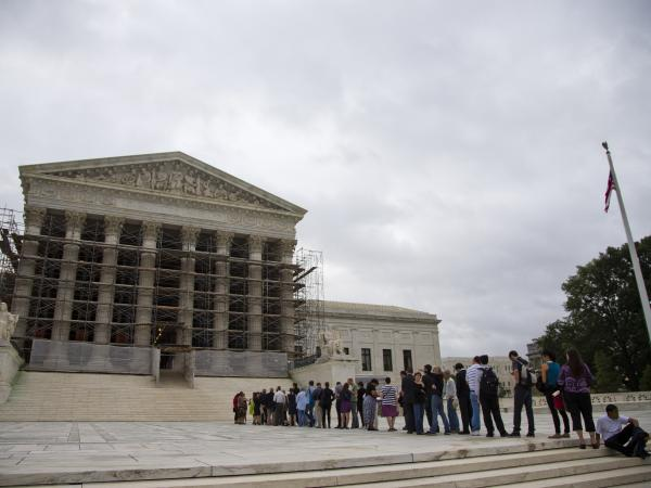 People wait in line for the beginning of the 2013-2014 Supreme Court term in Washington on Oct. 7. The court heard the first major case on campaign contribution limits since 2010's landmark <em>Citizens United</em>.
