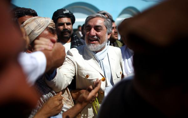 Presidential candidate Dr. Abdullah Abdullah is greeted by well wishers at the Kandahar airport in southern Afghanistan. He finished second in the 2009 presidential election and is one of the leading candidates going into Saturday's voting.