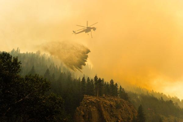 A Type 1 helicopter, known as a snorkel, drops water on the High Park Fire near Fort Collins, Colo., June, 2012.