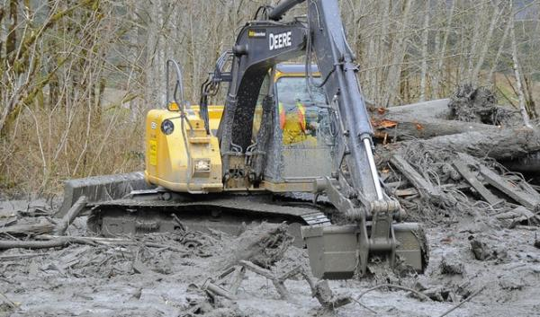 An excavator working in the debris field near Oso, Wash., where a mudslide destroyed a neighborhood in March. The death toll reached 28 as of April 2.