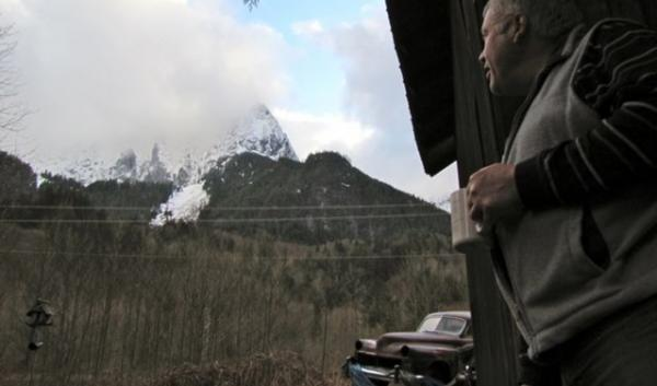 """Maybe that hillside is a danger to me,"" says Ben Van Dusen, looking towards the steep foothills of Mt. Index less than a 1/4 mile from his home. ""I didn't think it was but maybe it is."""