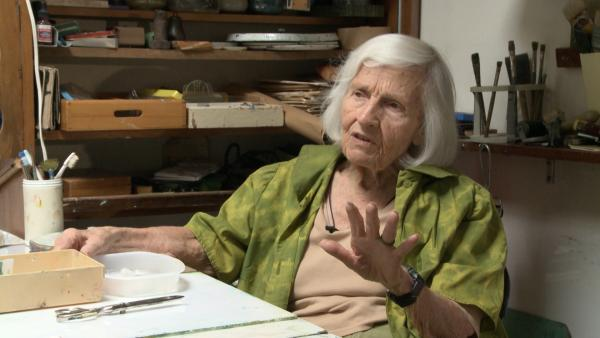 Artist Marian Busey discusses her work inside her studio..