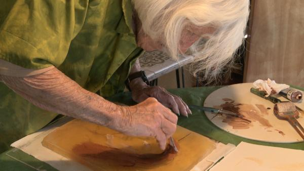 Busey at work on a hand-pulled print.