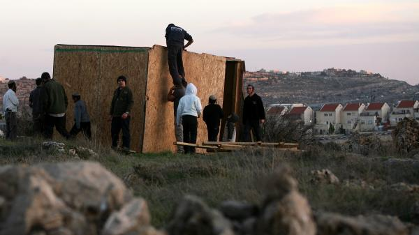 Jewish settlers from Kiryat Arba and Kharsina in the West Bank start to rebuild houses at a nearby unauthorized outpost, on Feb. 21. The Israeli government considers the outposts illegal and occasionally tears them down.