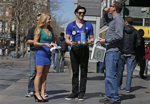 A strong majority of young voters support the Affordable Care Act, according to a new NPR poll. In March 2014, models handed out juice shots to encourage individuals — and especially young people — to sign up for health insurance.