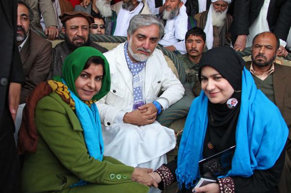 Supporters pose for a photo with Afghan presidential candidate Abdullah Abdullah — one of three front-runners — during a campaign rally in Herat, Afghanistan, on April 1.