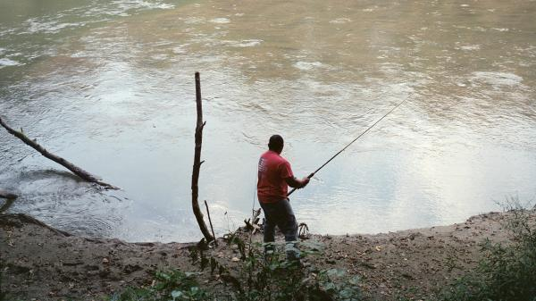 Frank Cedillo fishes in a Greenville, Tenn., lake.