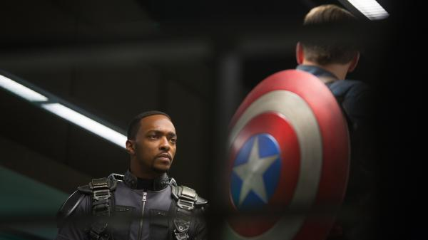 Anthony Mackie as Falcon and Chris Evans as Captain America.