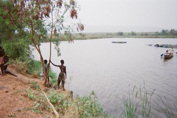 Reuben Allotuynii and a friend look out over the dam in Kordiabe, Ghana, a place where they swim, wash clothes and get their drinking water.