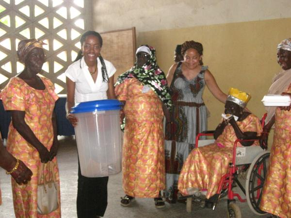 Sylvia Baffour holds a water filter which she donated to women at a leper colony near Koridabe in 2010. Her business partner Beverly Hunt is third from right.