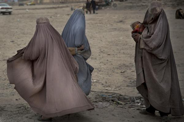 Afghan women beg in the street for money in the center of Kandahar on March 12. Kandahar, the capital of the province with the same name, is the birthplace of the hard-line Islamic militant movement that held power in the country for five years until it was ousted in a 2001 U.S.-led invasion.