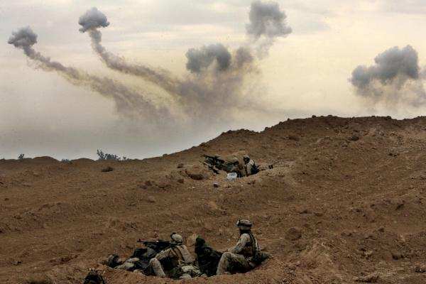 U.S. Marines of the 1st Division take position on the outskirts of Fallujah, Iraq, on Nov. 8, 2004.