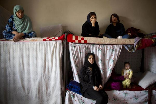 "Afghan female prisoners in 2013 in their cell at Badam Bagh, Afghanistan's central women's prison, in Kabul. The majority of the women are serving sentences of up to seven years for leaving their husbands, refusing to accept a marriage arranged by their parents, or choosing to leave their parents' home with a man of their choice, all so-called ""moral"" crimes."