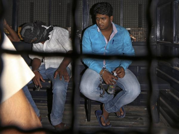 Mohammad Qasim Shaikh (right) and another accused in a gang rape case are taken to a court session last month in Mumbai.