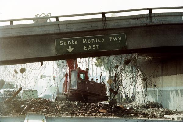 A picture taken on January 19, 1994 in Los Angeles shows a bulldozer tearing down a section of the Santa Monica Freeway that collapsed during the massive Northridge earthquake. A huge earthquake this week in Chile and two minor quakes in California are raising concerns if California is prepared in the even of another major earthquake.(Timothy A. Clary/AFP/Getty Images)