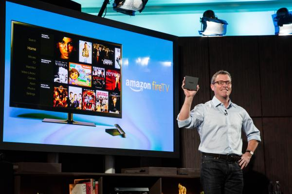 Amazon's vice president of Kindle, Peter Larsen, displays the Amazon Fire TV.
