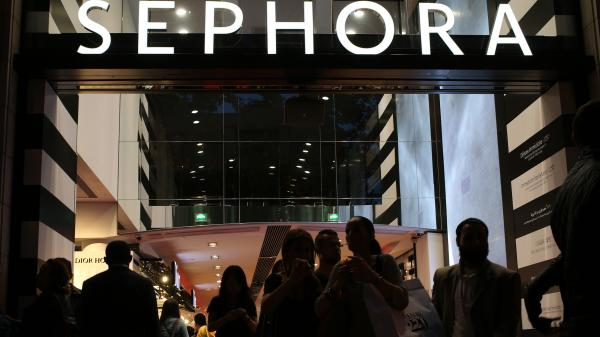The Paris Sephora store, seen here on a night last fall night on the Champs-Elysees, must close at 9 p.m., a high court has ruled. The cosmetics chain had required workers to keep the store open until midnight.