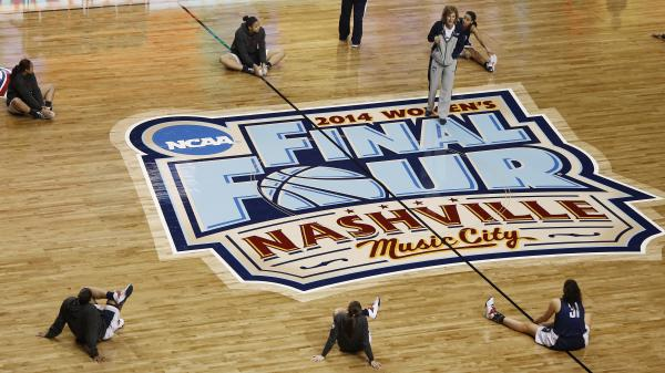 Connecticut players stretch during practice on the court hosting the women's Final Four in Nashville. The games tip off today with a 6:30 p.m. ET start time.