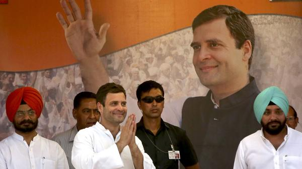 Rahul Gandhi, leader of India's ruling Congress Party (second left), at an April 6 rally in New Delhi. A softening economy and corruption scandals have led to the Congress Party's hold on power being challenged.