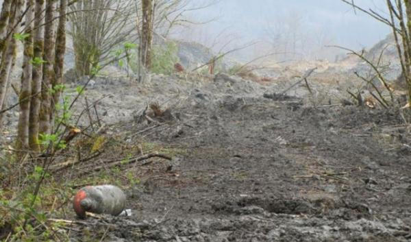 Propane tanks floated to the surface of the massive landslide debris field that engulfed 42 homes near Oso, Washington.