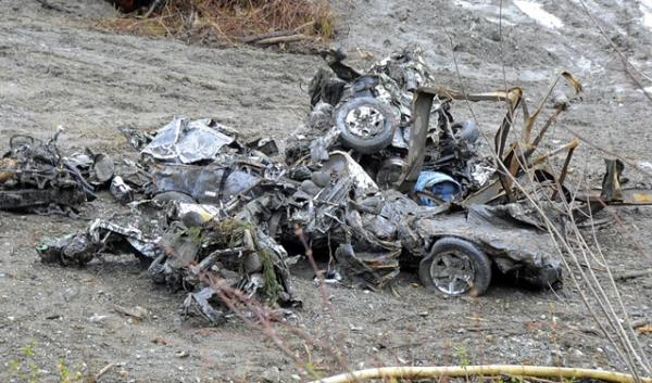 Wrecked cars and a plastic barrel are among the debris that some clean-up crews are focusing on at the site of the Oso slide site. Officials are beginning to assess potential environmental and public health risks.