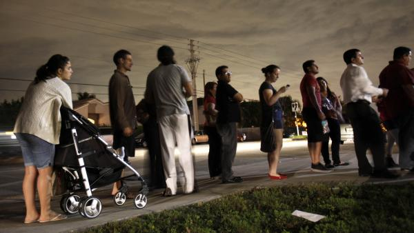 Voters line up in the dark to cast their ballots at a polling station on Nov. 6, 2012 in Miami, Fla.