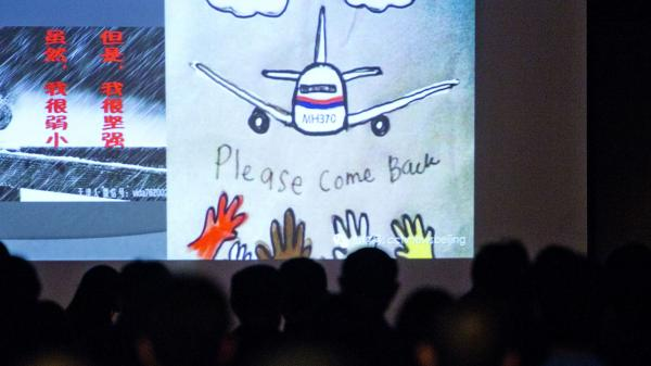 Artwork capturing hope held for Malaysia Airlines Flight 370, shown in Beijing on March 29.