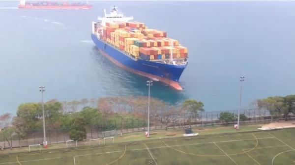 The 633-foot container ship Hanza Constitution runs aground in Hong Kong.