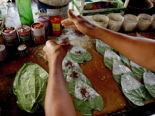 A man prepares betel leaves to sell at his roadside stall in Yangon, Myanmar, in 2009.