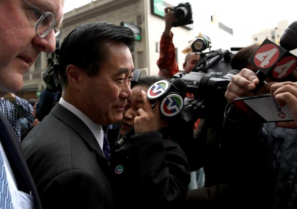 Calif. State Sen. Leland Yee (second from left) is surrounded by members of the media as he leaves the Phillip Burton Federal Building after a court appearance on March 31, 2014 in San Francisco.