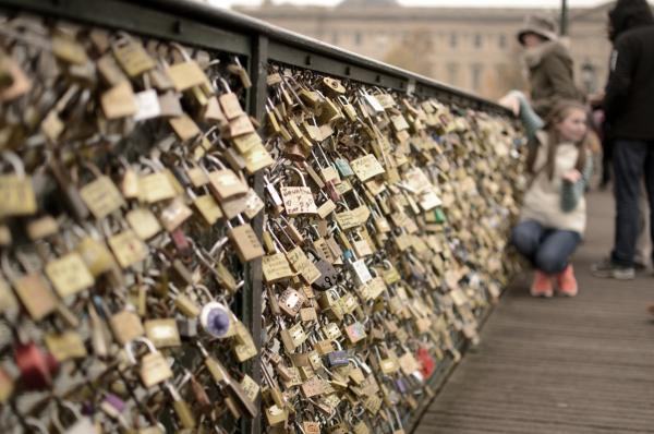 No one knows where this practice started, but  hundreds of thousands of locks adorn bridges in Paris. (Carlo Occiena/Flickr)