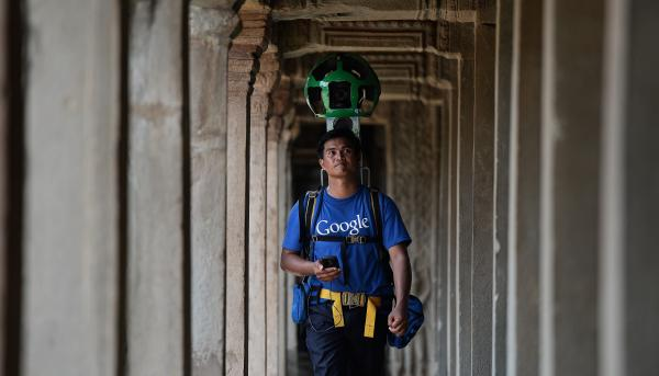"A Cambodian technician carries a backpack-mounted ""Trekker"" device housing 15 cameras as he demonstrates the technique used to digitally map the Angkor complex in Cambodia."