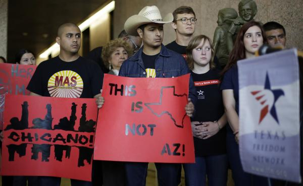 Supporters of a proposal to add a Mexican-American studies course as a statewide high school elective arrive for a Texas Board of Education hearing on Tuesday.