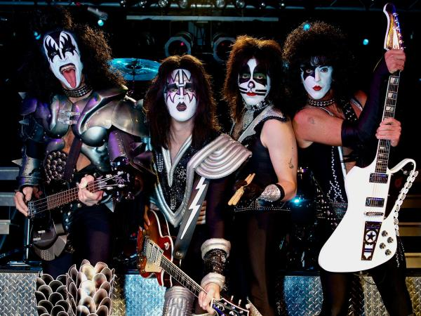 """We're fans, just like the people that come to see us,"" says Rich Kosak (far right), who plays the role of KISS vocalist Paul Stanley in the Ohio tribute band Mr. Speed."